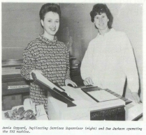 A gender-balanced team of secretaries stand next to Sussex's first ever fax machine (2005)