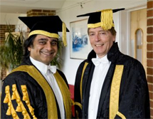 A bumbling hack holding a largely ceremonial position entailing little actual work; and Sanjeev Bhaskar.
