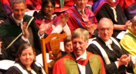 Pro-VC Claire Mackie (front row), VC Michael Farthing (partially obscured) and Deputy VC Michael Davies (right) react to my passing. They all featured in a song in last week's post.